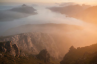 Mist conceals coastal landscape from summit of Offersøykammen, Vestvågøya, Lofoten Islands, Norway