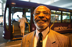 Man standing in front of a bus at the bus station,