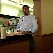 Portrait of Deniz Aslan, owner of Cross Cafe, Parson Cross, Sheffield, South Yorkshire, UK