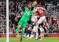 Football - 2018 / 2019 Premier League - Arsenal vs. Tottenham Hotspur<br /> <br /> Rob Holding (Arsenal FC) gets his head on the ball to deflect the cross at The Emirates.<br /> <br /> COLORSPORT/DANIEL BEARHAM