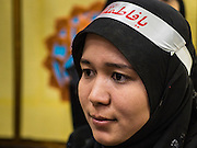 20 OCTOBER 2015 - YANGON, MYANMAR: A Shia Muslim woman waits for firewalking to start at Punja Mosque in Yangon. Ashura commemorates the death of Hussein ibn Ali, the grandson of the Prophet Muhammed, in the 7th century. Hussein ibn Ali is considered by Shia Muslims to be the third imam and the rightful successor of Muhammed. He was killed at the Battle of Karbala in 610 CE on the 10th day of Muharram, the first month of the Islamic calendar. According to Myanmar government statistics, only about 4% of the population is Muslim. Many Muslims have fled Myanmar in recent years because of violence directed against Burmese Muslims by Buddhist nationalists.    PHOTO BY JACK KURTZ