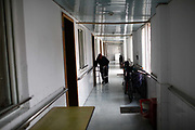A resident walks down an hallway at a small community run retirement home on the outskirts of Shanghai, China, on Tuesday, Dec. 13, 2011. China has about  36000 institutions and 2.7 million beds serving the elderly, enough for 1.6 percent of the population over 60, according to the World Bank.