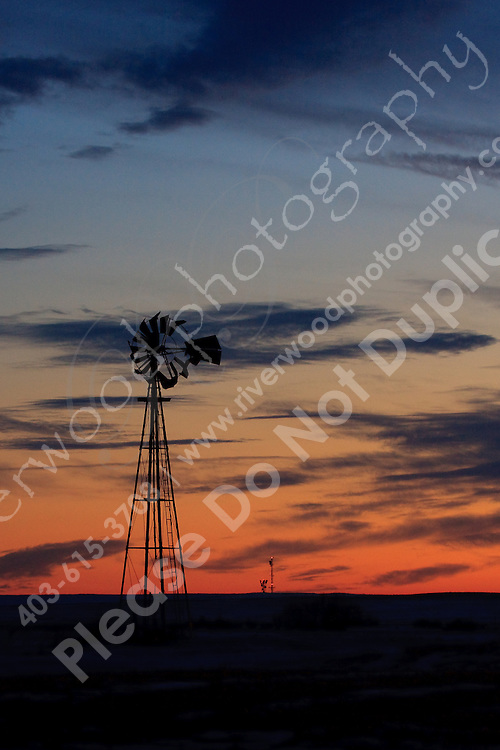 The prairie landscape is littered with aged and rusting farm equipment.  This relic of a windmill sits abandoned in an open farm field...©2009, Sean Phillips.http://www.Sean-Phillips.com
