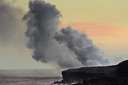 Steam rises as lava from middle east rift zone of the Kilauea volcano enters the ocean at sunset near the Kalapana viewing site managed by Hawaii County Civil Defense on the Big Island of Hawaii.