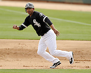 GLENDALE, AZ - MARCH 05:  Eduardo Escobar #38 of the Chicago White Sox runs the bases against the Los Angeles Dodgers on March 5, 2012 at The Ballpark at Camelback Ranch in Glendale, Arizona. The Dodgers defeated the White Sox 6-4.  (Photo by Ron Vesely)  Subject:  Eduardo Escobar