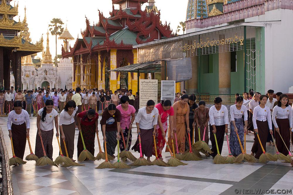 Women clean the floor at Shwedagon Pagoda in Rangoon, Burma.
