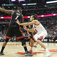 14 March 2012: Chicago Bulls center Joakim Noah (13) defends on Miami Heat power forward Chris Bosh (1) during the Chicago Bulls 106-102 victory over the Miami Heat at the United Center, Chicago, Illinois, USA.