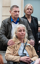© Licensed to London News Pictures. 11/11/2015. Bristol, UK.  DARREN GALSWORTHY the father of murder victim Rebecca Watts, wheels his wife ANJIE GALSWORTHY the mother of Nathan Matthews who was found guilty of Becky's murder, at a press call outside Bristol Crown Court after the verdicts were given by the jury in the case of the murder of Rebecca Watts.  Photo credit : Simon Chapman/LNP