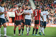 AFC Bournemouth Midfielder, Harry Arter (8) feels his face after a possible elbow from Tottenham Hotspur Midfielder, Moussa Sissoko (17) during the Premier League match between Bournemouth and Tottenham Hotspur at the Vitality Stadium, Bournemouth, England on 22 October 2016. Photo by Adam Rivers.