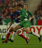 Photo. Daniel Hambury.<br /> FIFA World Cup 2006 Qualifier.<br /> France V Republic of Ireland. 09/10/2004.<br /> France's Thierry Henry and Ireland's Kevin Kilbane