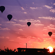 Hot air balloons silhouette in Goreme valley at sunrise, Cappadocia, Turkey