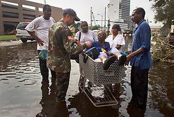 01 Sept, 2005. New Orleans, Louisiana.<br /> Mass evacuation begins. Having not gone through the proper channels and having simply turned up unannounced, an elderly lady is refused access to the busses as exhausted former residents of the Superdome 'shelter of last resort' wade through flood water to get to the first busses evacuating people from New Orleans to destinations unknown.<br /> Photo©; Charlie Varley/varleypix.com