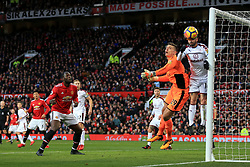 26th December 2017 - Premier League - Manchester United v Burnley - Burnley goalkeeper Nick Pope and teammate Steven Defour combine to clear the ball off the line as Romelu Lukaku of Man Utd looks on - Photo: Simon Stacpoole / Offside.