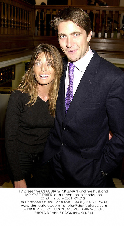 TV presenter CLAUDIA WINKLEMAN and her husband MR KRIS THYKIER, at a reception in London on 22nd January 2001.	OKO 21