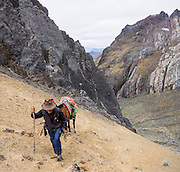 Juan ascends with a horse up the steep and slippery Yanacon/Yanajanca col (15,100 ft or 4610 m). Day 5 of 10 days trekking around Alpamayo, in Huascaran National Park (UNESCO World Heritage Site), Cordillera Blanca, Andes Mountains, Peru, South America. This panorama was stitched from 3 overlapping photos.