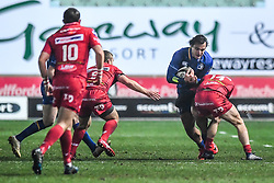 Leinster's James Lowe is tackled by Scarlets' Ioan Nicholas<br /> <br /> Photographer Craig Thomas/Replay Images<br /> <br /> Guinness PRO14 Round 17 - Scarlets v Leinster - Friday 9th March 2018 - Parc Y Scarlets - Llanelli<br /> <br /> World Copyright © Replay Images . All rights reserved. info@replayimages.co.uk - http://replayimages.co.uk