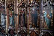 A detail of the medieval rood screen in the Church of St. Michaels, Aylsham which survived Puritan reformers, on 10th August 2020, in Aylsham, Norfolk, England. The rood screen was freshly gilded and painted in the early 16th Century but badly damaged by puritan reformers although sixteen painted figures can still be seen. The Church of St Michael and all Angels, Aylsham, Norfolk is a church of medieval origins that was built in the 14th century under the patronage of John of Gaunt, lord of the manor of Aylsham.
