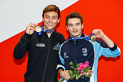 Tom Daley from Dive London Aquatics Club and Daniel Goodfellow from Plymouth Diving pose with their Gold Medals after winning the Mens Synchronised 10m Platform Final to all but guarantee their selection for the Rio 2016 Olympic Games - Mandatory byline: Rogan Thomson/JMP - 10/06/2016 - DIVING - Ponds Forge - Sheffield, England - British Diving Championships 2016 Day 1.