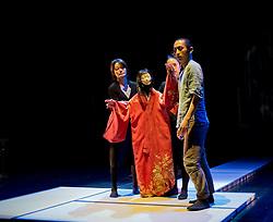 "© Copyright licensed to London News Pictures. 05/11/2010. Young Sasuke (Songha cho) receives a slap from Shun-Kin (Puppeteers Eri Fukatsu, Junko Uchida, Yasuyo Mochizuki). Complicite present ""Shun-Kin"" at the Barbican, London. Directed by Simon McBurney, based on the writings of Jun'ichiro Tanizaki."