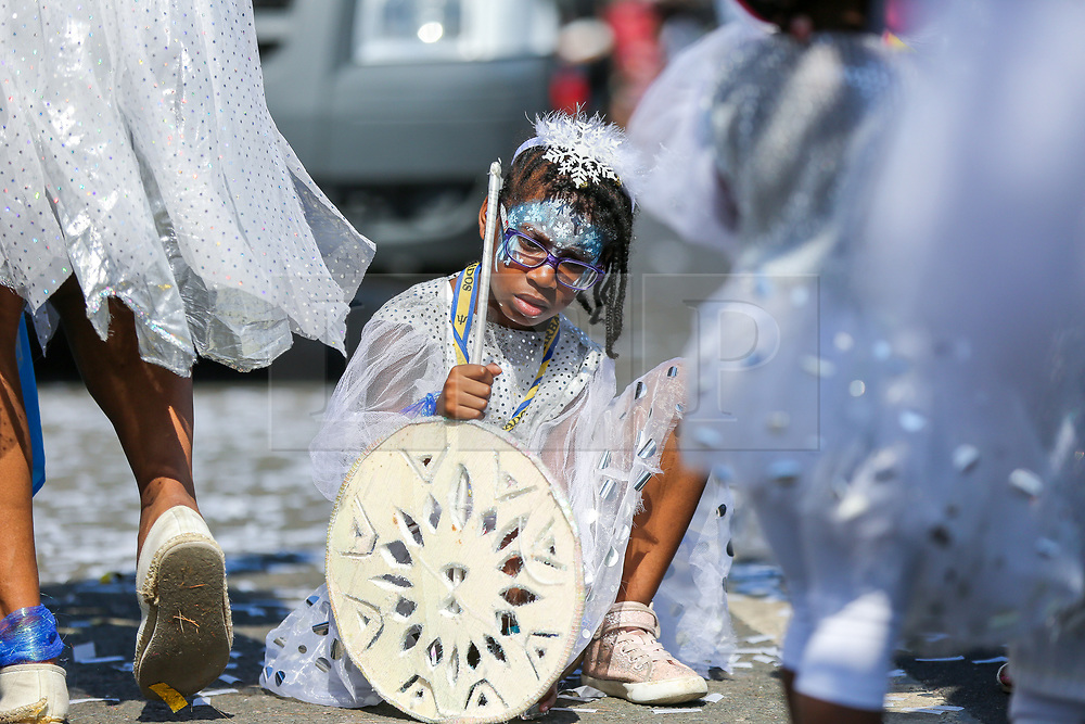 © Licensed to London News Pictures. 26/08/2019. London, UK. A young dancers takes rest during the parade on a very hot day of Notting Hill Carnival in west London. Thousands of revellers take part in Notting Hill Carnival, Europe's largest street party and a celebration of Caribbean traditions and the capital's cultural diversity. Photo credit: Dinendra Haria/LNP