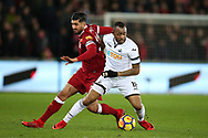 Jordan Ayew of Swansea city holds off Emre Can of Liverpool (l). Premier league match, Swansea city v Liverpool at the Liberty Stadium in Swansea, South Wales on Monday 22nd January 2018. <br /> pic by  Andrew Orchard, Andrew Orchard sports photography.