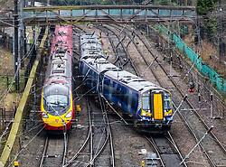 Scotrail passenger train and Virgin Trains train and tracks at  Waverley Station in Edinburgh, Scotland, United Kingdom