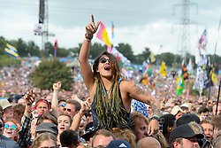 A festivalgoer watches Royal Blood on The Pyramid Stage at the Glastonbury Festival, at Worthy Farm in Somerset. PRESS ASSOCIATION Photo. Picture date: Friday June 23, 2017. See PA story SHOWBIZ Glastonbury. Photo credit should read: Ben Birchall/PA Wire