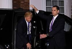 President-elect Donald leaves the clubhouse of Trump International Golf Club, after a day of meetings, November 19, 2016 in Bedminster Township, New Jersey. (Aude Guerrucci / Pool)