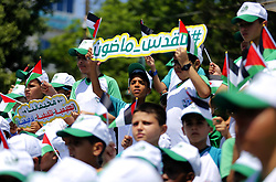 July 8, 2017 - Gaza City, The Gaza Strip, Palestine - Palestinian children take part in a summer camp organized by Hamas on July 8, 2017. Thousands of elementary school students in the Gaza Strip are going to Hamas summer camps, in which they take part in recreational activities and participate in political demonstrations in solidarity with Palestinian prisoners held in Israeli jails. (Credit Image: © Mahmoud Issa/Quds Net News via ZUMA Wire)
