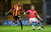 Lincoln City's Harry Anderson vies for possession with Bradford City's Kurtis Guthrie<br /> <br /> Photographer Chris Vaughan/CameraSport<br /> <br /> Carabao Cup Second Round Northern Section - Bradford City v Lincoln City - Tuesday 15th September 2020 - Valley Parade - Bradford<br />  <br /> World Copyright © 2020 CameraSport. All rights reserved. 43 Linden Ave. Countesthorpe. Leicester. England. LE8 5PG - Tel: +44 (0) 116 277 4147 - admin@camerasport.com - www.camerasport.com