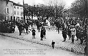 Entry of French troops into Chateau-Salins, Lorraine, 17 November 1918. General Daugan, Commander of the Moroccan Division, taking the salute  as the Foreign Legion marches through the town. First World War 1914-1918.  Postcard