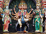 Hindu figures at start of 272 steps leading to Batu Caves with a Hindu Temple deep inside, Salangor, Malaysia.