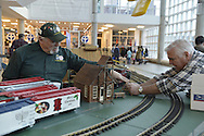 Dec. 26, 2012 - Garden City, New York, U.S. - The Long Island Garden Railway Society large-scale model train display surrounds a large decorated tree for a festive winter holiday attraction in the vast 3-floor atrium of Cradle of Aviation museum, until shortly after New Years Day 2013. LIGRS shares the knowledge, fun, and camaraderie of large-scale railroading both indoors and in the garden, and is family oriented.
