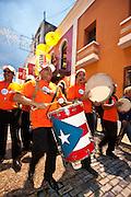 A band parades through the streets of Old San Juan January 13, 2011 during the Festival of San Sebastian in San Juan, Puerto Rico.