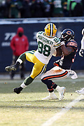 Green Bay Packers running back Ty Montgomery (88) gets tackled by Chicago Bears free safety Adrian Amos (38) at the Chicago Bears 2 yard line as he runs the ball for a gain of 26 yards in the third quarter during the 2016 NFL week 15 regular season football game against the Chicago Bears on Sunday, Dec. 18, 2016 in Chicago. The Packers won the game 30-27. (©Paul Anthony Spinelli)