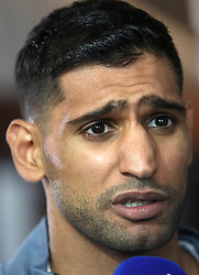 Amir Khan during the weigh in at Arena Birmingham.