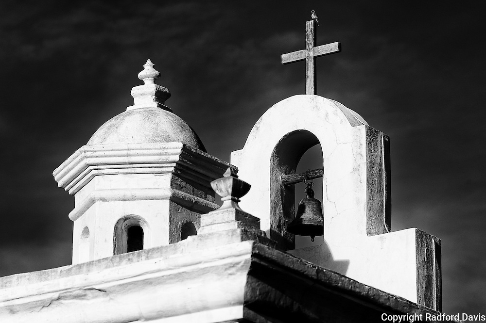 The bell and cross of the San Xavier Mission.