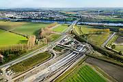 Nederland, Zeeland, Zeeuws-Vlaanderen, 19-10-2014; Sluiskil, Kanaal Gent-Terneuzen, kanaalkruising Sluiskil. Bouwpunt van de tunnel. De brug in de N61 sluit zeer regelmatig voor zeeschepen en dit veroorzaakt files. Daarom zal de kanaalbrug vervangen worden door een tunnel, de Sluiskiltunnel (oplevering 2015).<br /> The pivot bridge over the canal Gent-Terneuzen (Zeeland) closes very regularly for seagoing vessels and this causes traffic jams. Therefore, the canal bridge will be replaced by a tunnel, the tunnel Sluiskil (completion 2015).<br /> luchtfoto (toeslag op standard tarieven);<br /> aerial photo (additional fee required);<br /> copyright foto/photo Siebe Swart