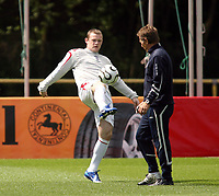 Photo: Chris Ratcliffe.<br />England training session. 06/06/2006.<br />Wayne Rooney warms up with the England team as Leif Sward, the England team doctor watches on.