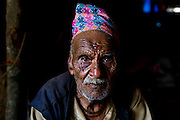 """30th April 2015, Sindhupal Chowk District, Nepal. Man Bahadur Bharati (87) in Bharatigaun village, Sindhupal Chowk District, on the 30th April 2015. <br /> He lived through the last major earthquake to hit Nepal 81 years ago in 1934. He was interviewed about the men from the village going overseas to work and said the village had changed for the better in the last 20 yrs, but now everything is at risk again. He said men started leaving to work overseas 10-12 yrs ago. """"The fields are barren, but the money is here."""" He said it would be good if families could stay together.<br /> <br /> Sindhupalchowk District has seen around 2100 deaths as of 3rd May 2015 which is nearly a third of all fatalities recorded in Nepal from the earthquake with magnitude 7.8 that occurred near Lamjung, Nepal, 50 miles northeast of the capital Kathmandu at 06:11:26 UTC on Apr 25, 2015. The capital has seen considerable devastation including the nine-story Dharahara Tower, one of Kathmandu's landmarks built by Nepal's royal rulers as a watchtower in the 1800s and a UNESCO-recognised historical monument. It was reduced to rubble and there were reports of people trapped. Portions of historic buildings in the World Heritage gazetted site of Patan have also been destroyed as well as many buildings in the old city. <br /> <br /> PHOTOGRAPH BY AND COPYRIGHT OF SIMON DE TREY-WHITE<br /> <br /> + 91 98103 99809<br /> email: simon@simondetreywhite.com<br /> photographer in delhi"""