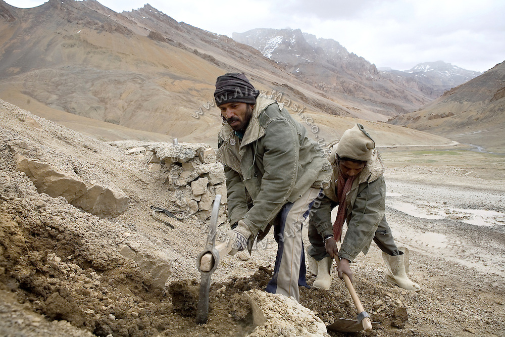 Labourers are fixing part of the Leh-Manali Highway.