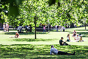 People appear to be enjoying a day of leisure in St James' Park in central London on Monday, June 22, 2020. The two-metre social distancing rule, which will be under review as the UK relax coronavirus lockdown measures implemented to stem the spread of the virus, appear to be challenged by the residents. Many also appear not to be wearing face protective masks meanwhile the UK's coronavirus death toll has passed more than 40,000, according to the latest government figures. A total of 40,261 people have died in hospitals, care homes and the wider community after testing positive for the virus. (Photo/ Vudi Xhymshiti)