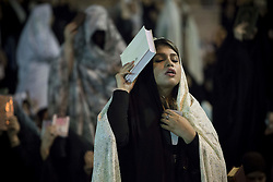 May 25, 2019 - Tehran, Tehran, Iran - Iranian worshipers pray at Imamzadeh Saleh on the 19th day of Ramadan as eventual Laylat al-Qadr (Night of Power), one of the Muslim's holiest nights, in Tehran, Iran. Iranian people assume that 19th, 21st and 23rd days of Ramadan are probable Laylat al-Qadr night and named as Shab-i Ihya. They gather in mosques on these three nights and pray until the morning. (Credit Image: © Rouzbeh Fouladi/ZUMA Wire)