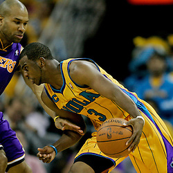 April 22, 2011; New Orleans, LA, USA; New Orleans Hornets point guard Chris Paul (3) drives past Los Angeles Lakers point guard Derek Fisher (2) during the second half in game three of the first round of the 2011 NBA playoffs at the New Orleans Arena. The Lakers defeated the Hornets 100-86.   Mandatory Credit: Derick E. Hingle
