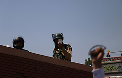 September 5, 2017 - India - A paramilitary trooper filming the protest of Jammu and Kashmir Bar Association members who took to streets to protest against the summoning of their president, Mian Abdul Qayoom to New Delhi by National Investigation Agency (NIA) for questioning regarding the alleged terror funding case in Srinagar, Indian  Controlled Kashmir on Tuesday, September 05, 2017. NIA earlier arrested scores of pro-freedom leaders over the alleged terror funding case who have been either languishing in Delhi Jail on in NIA custody. (Credit Image: © Umer Asif/Pacific Press via ZUMA Wire)
