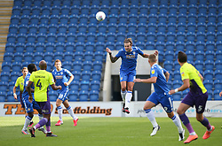 Harry Pell of Colchester United heads the ball - Mandatory by-line: Arron Gent/JMP - 18/06/2020 - FOOTBALL - JobServe Community Stadium - Colchester, England - Colchester United v Exeter City - Sky Bet League Two Play-off 1st Leg