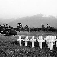A US supplied Apache helicopter sits on a landing zone at a forward operating base near a symbolic cemetery for soldiers killed in combat. Tame, Aruaca.<br />