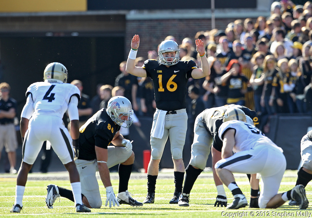November 10 2012: Iowa Hawkeyes quarterback James Vandenberg (16) signals his team at the line during the NCAA football game between the Purdue Boilermakers and the Iowa Hawkeyes at Kinnick Stadium in Iowa City, Iowa on Saturday, November 10, 2012. Purdue defeated Iowa 27-24.