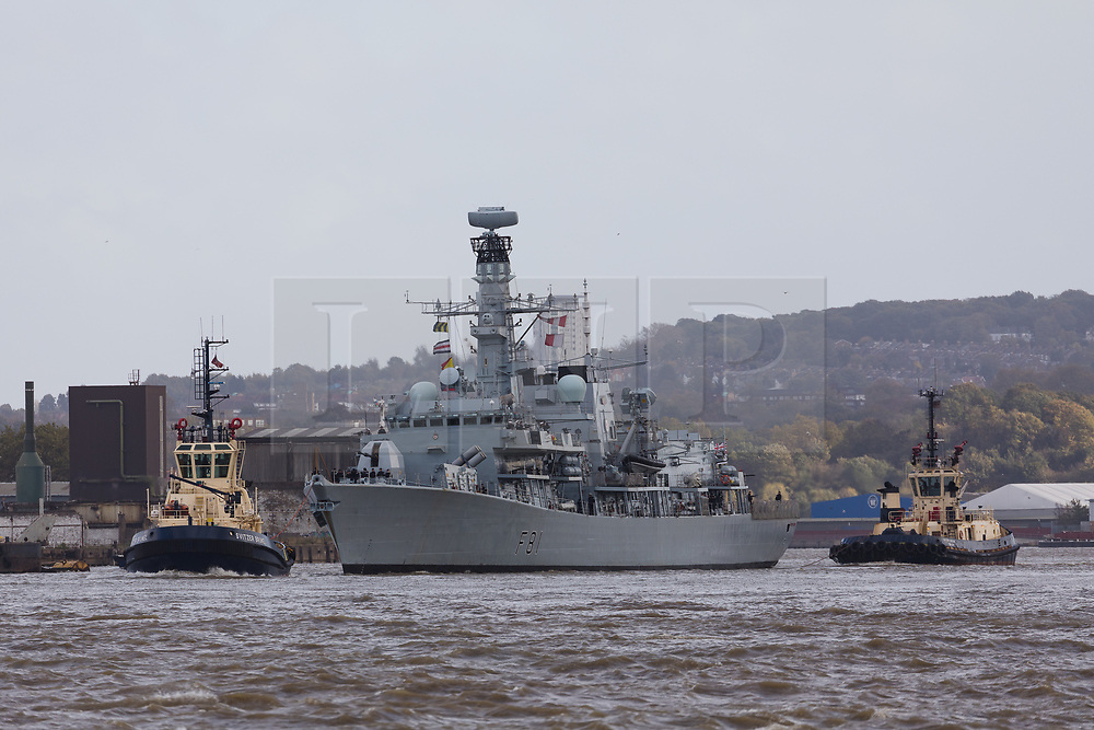 © Licensed to London News Pictures. 21/10/2017. LONDON, UK.  HMS Sutherland, a Type 23 frigate of the British Royal Navy travels on the River Thames, approaching West India Dock, Canary Wharf for Trafalgar Day celebrations. The ship is celebrating the 20th anniversary of her commissioning this year and will be visited by Her Majesty the Queen next week..  Photo credit: Vickie Flores/LNP