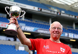 England's Tommy Charlton holds the trophy after England's victory in the Over 60s Just International Cup against Italy in the Walking Football International match at The AMEX Stadium, Brighton.